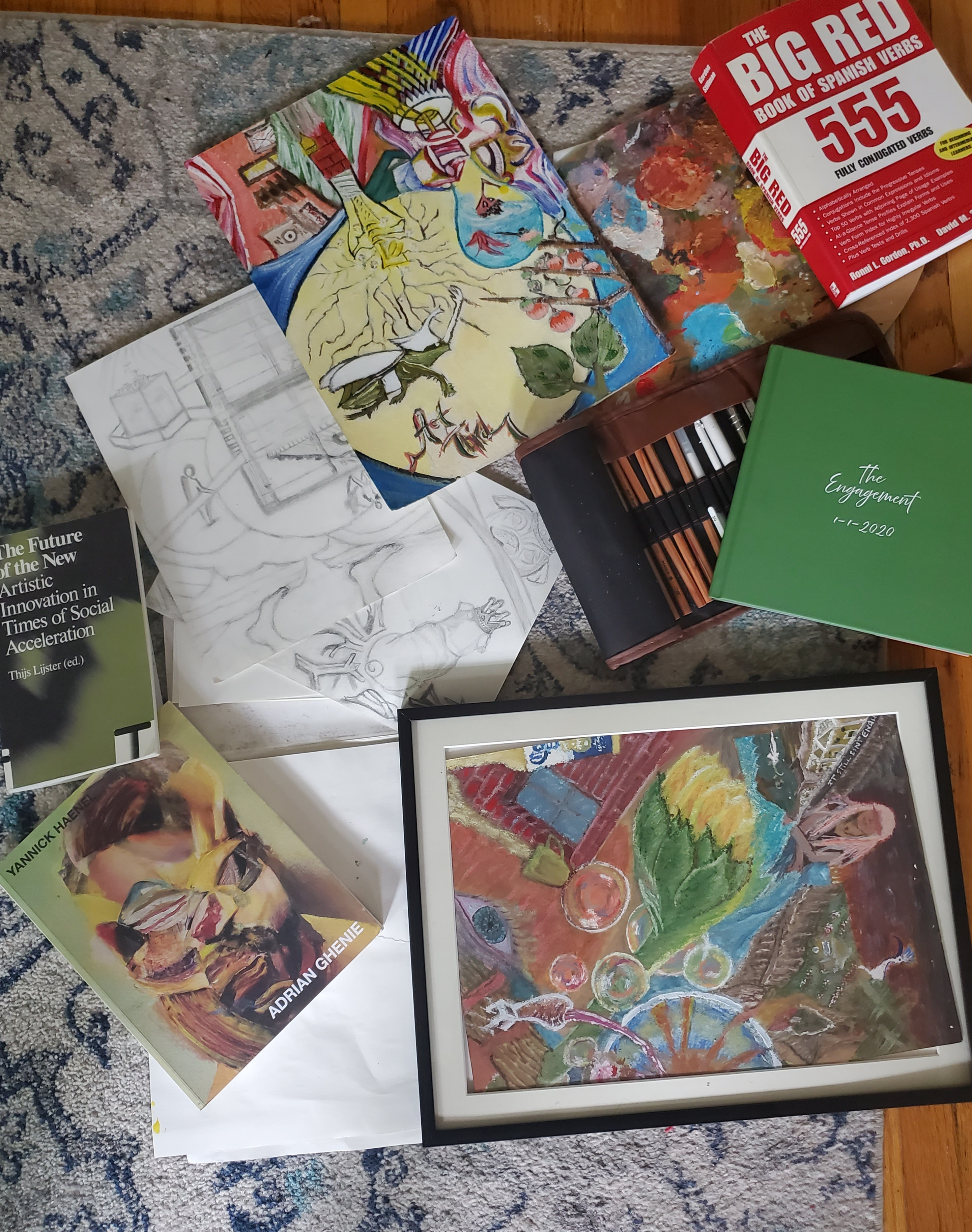 An image of paintings and art supplies