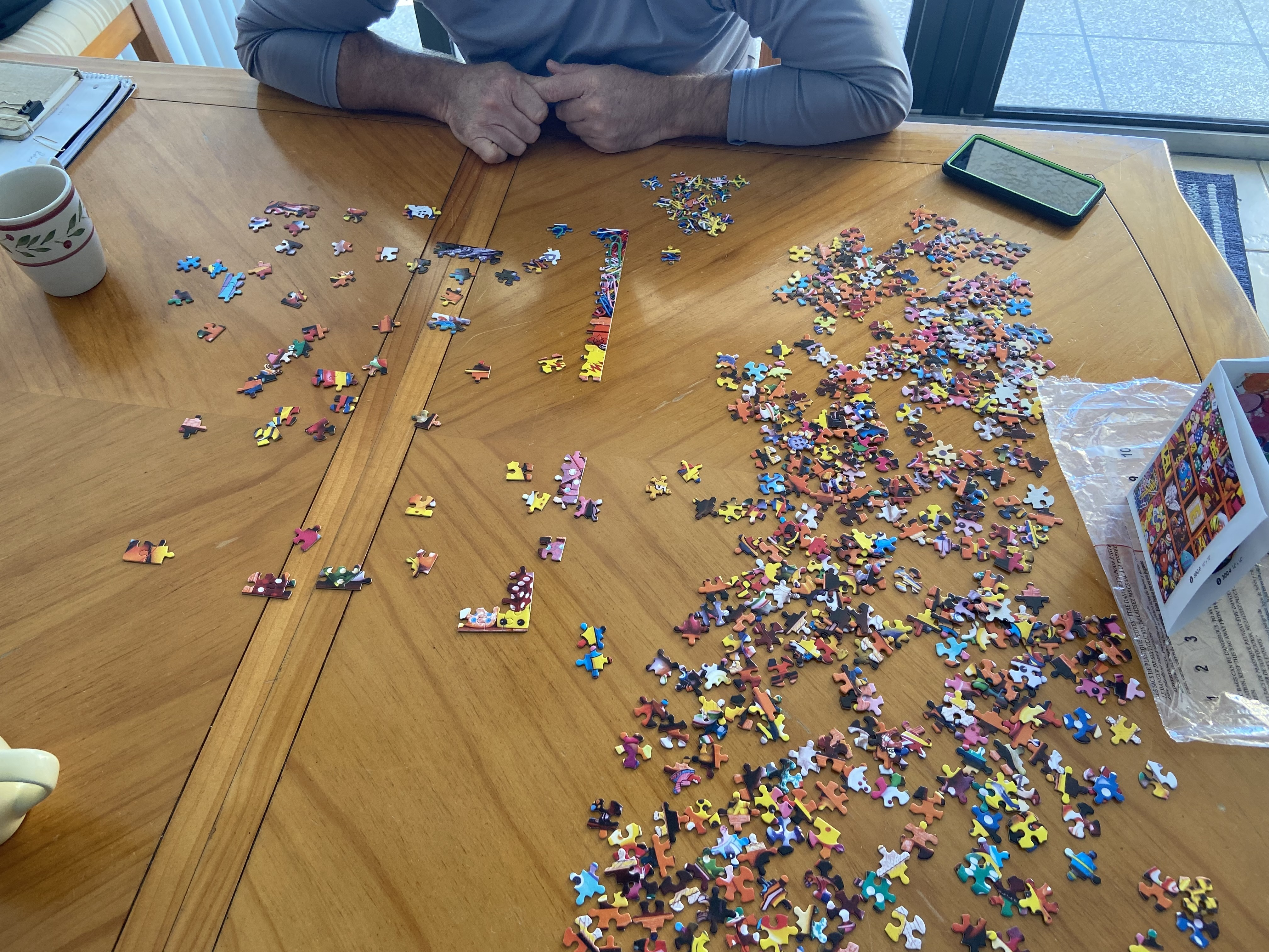 An image of someone putting together a puzzle