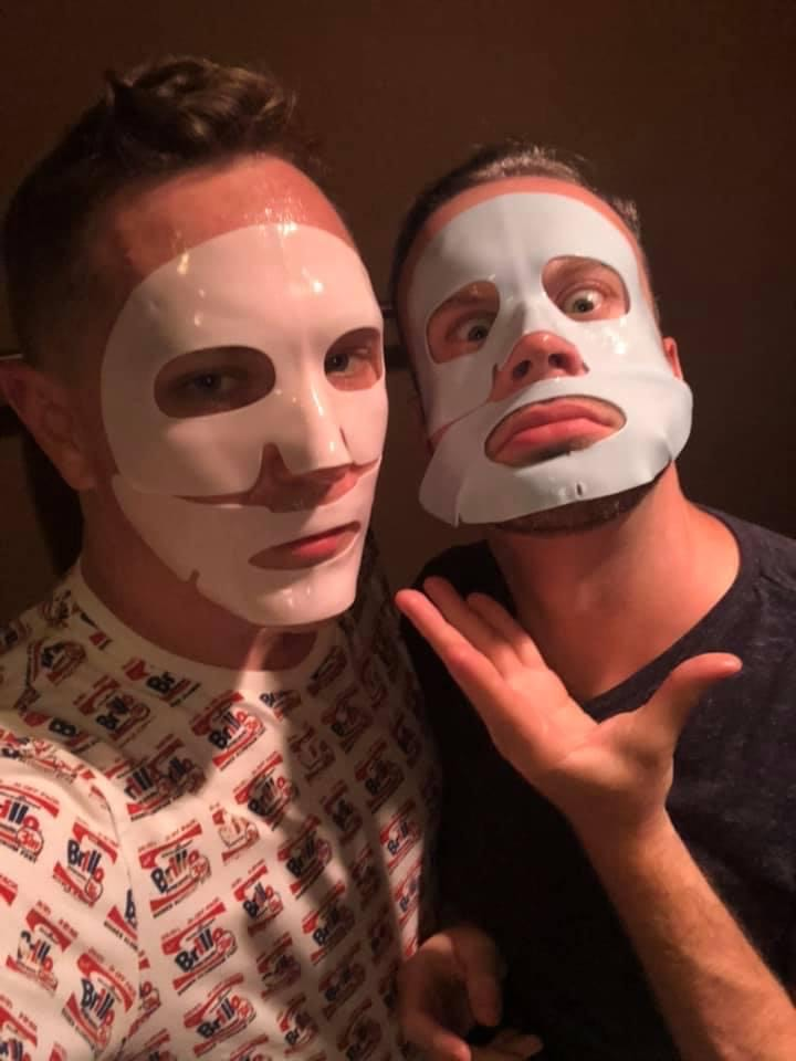 An image of two people wearing face masks