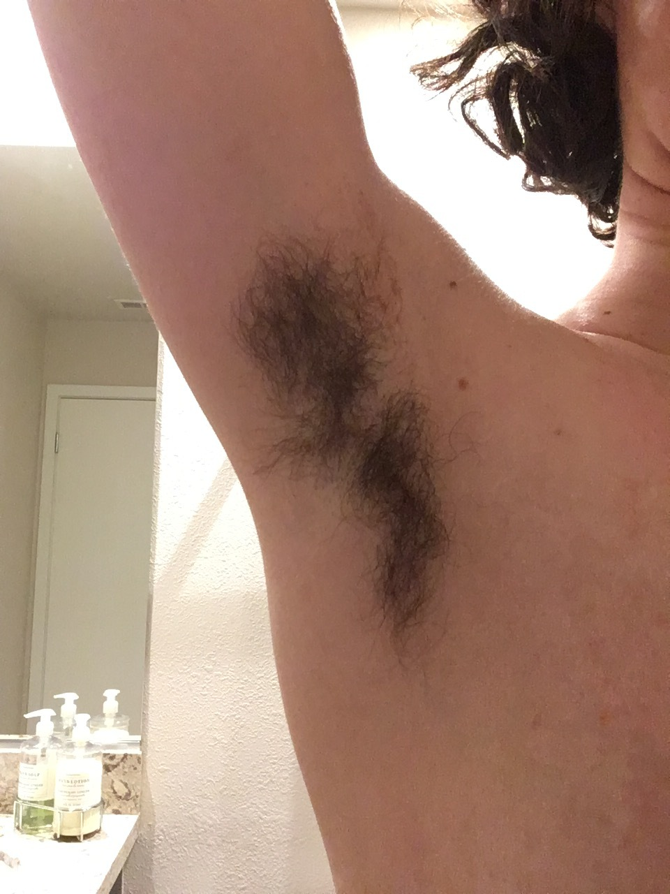 An image of unshaved underarm hair