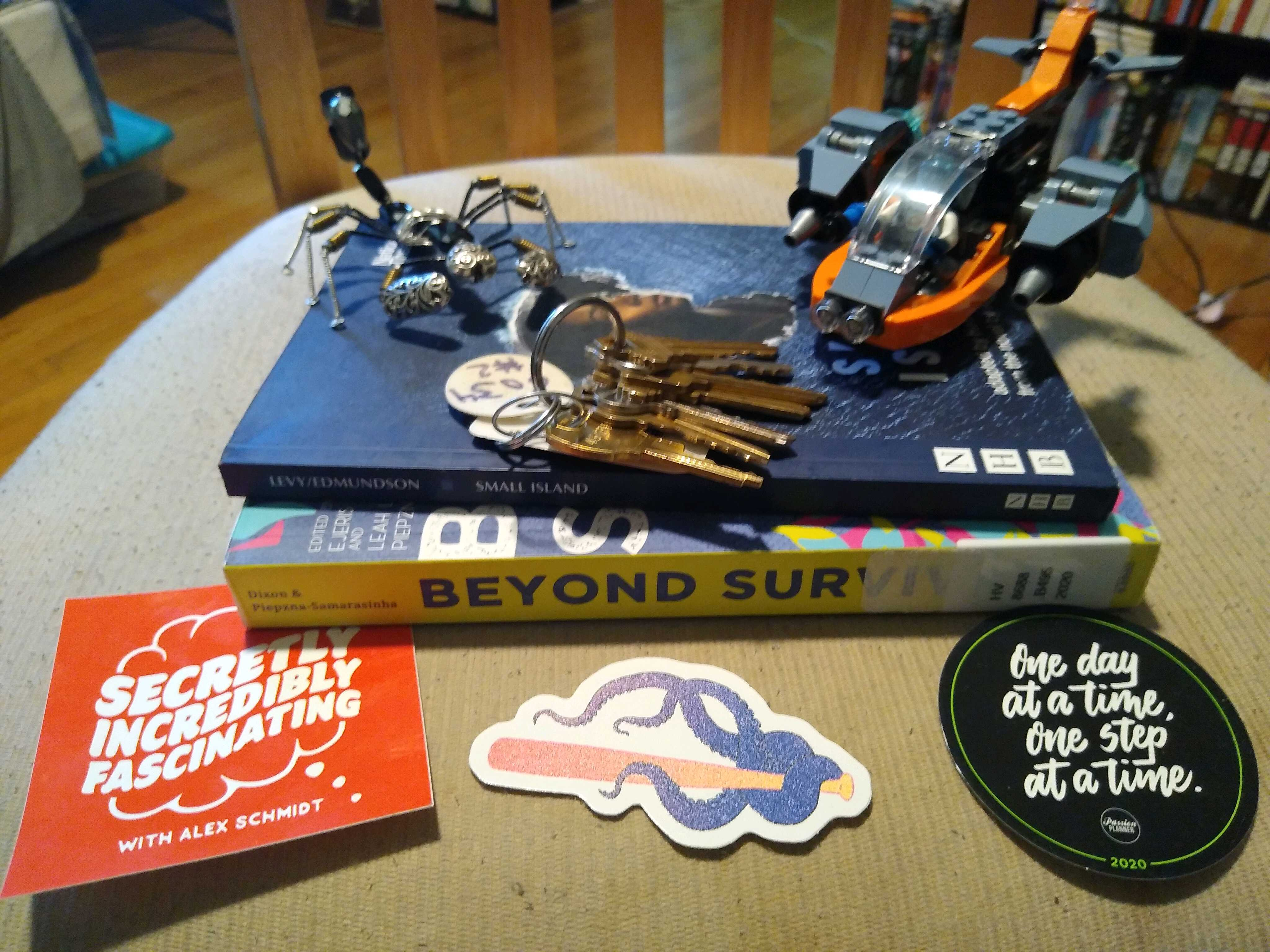 An image of Legos, keys, stickers, and books.